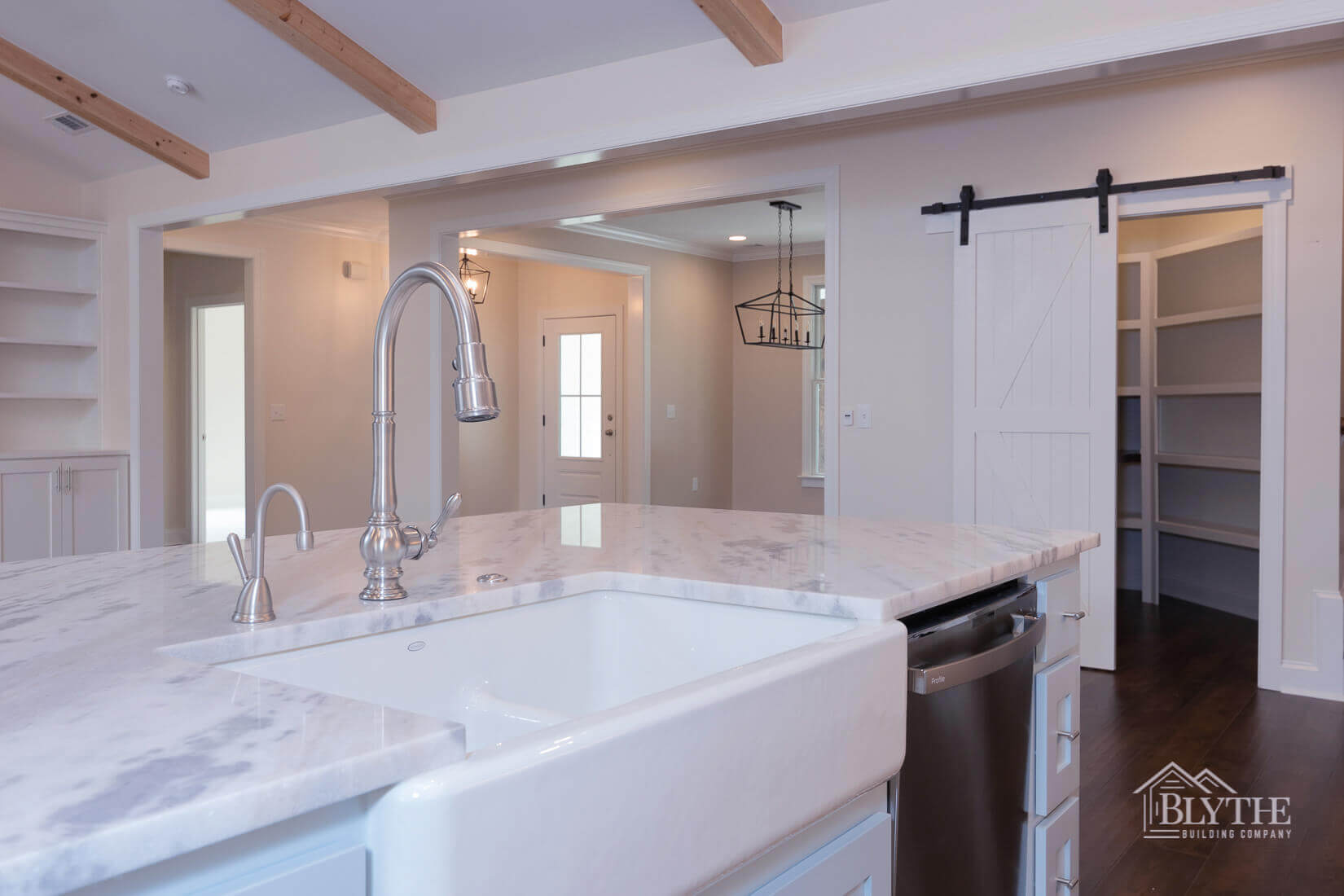 closeup to sink in kitchen and barndoor home builder sc