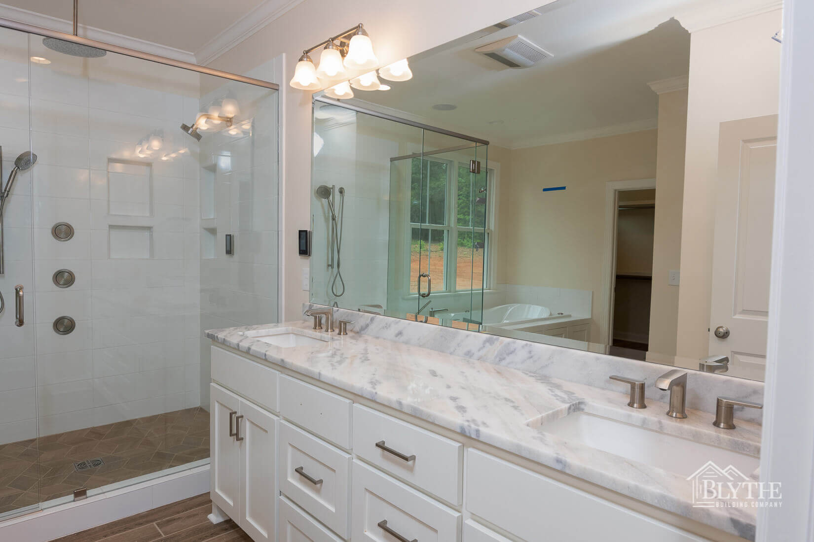 view into bathroom marble top sink and shower home builder sc