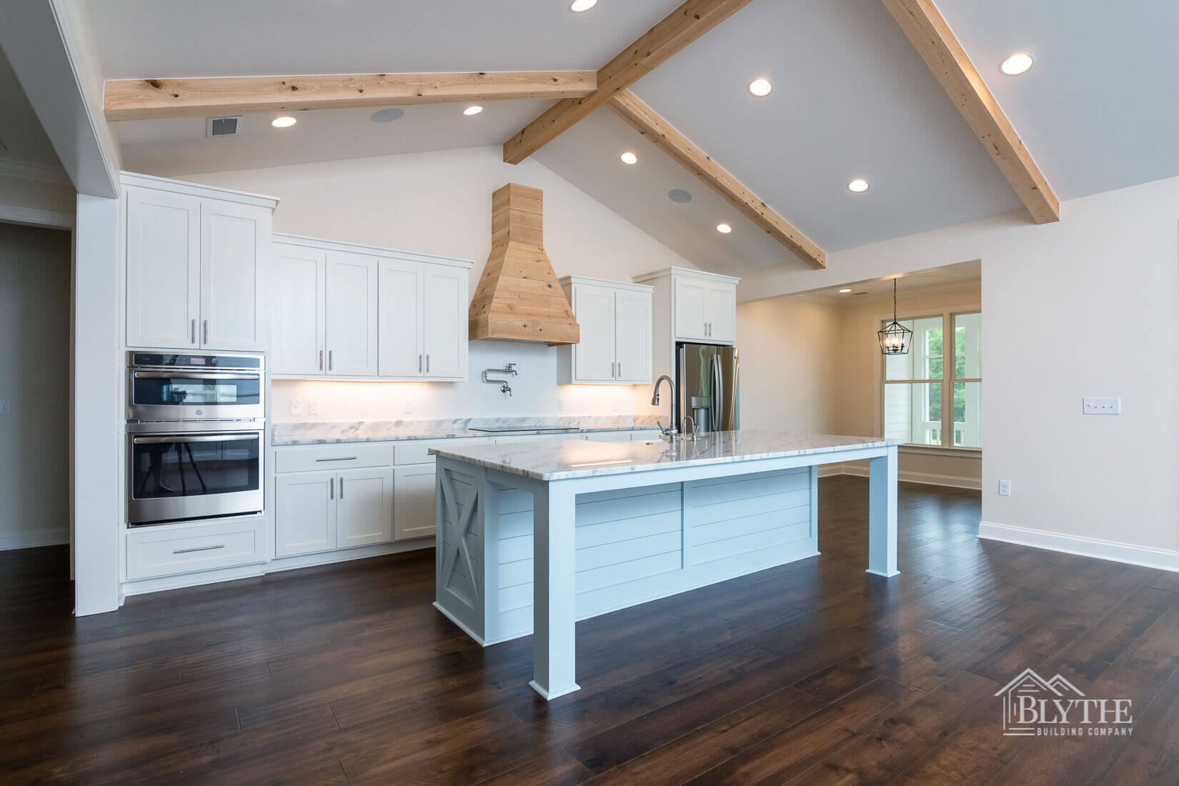 wooden ceiling beams kitchen view home builder sc